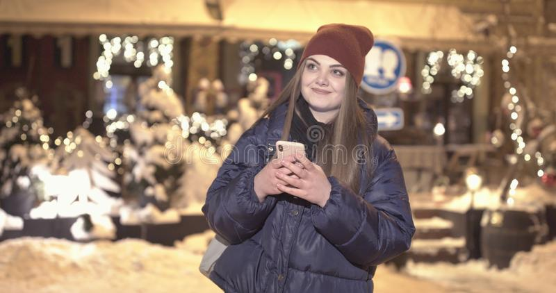 Woman using Mobile Phone of Night Town stock image