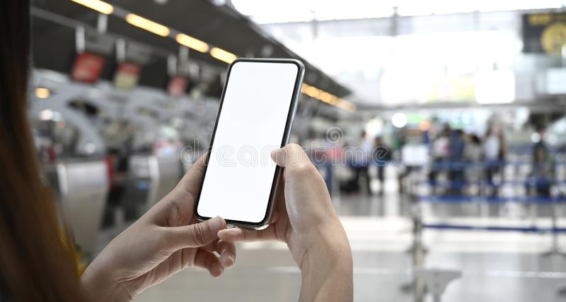 Woman using mobile phone in terminal airport stock photos