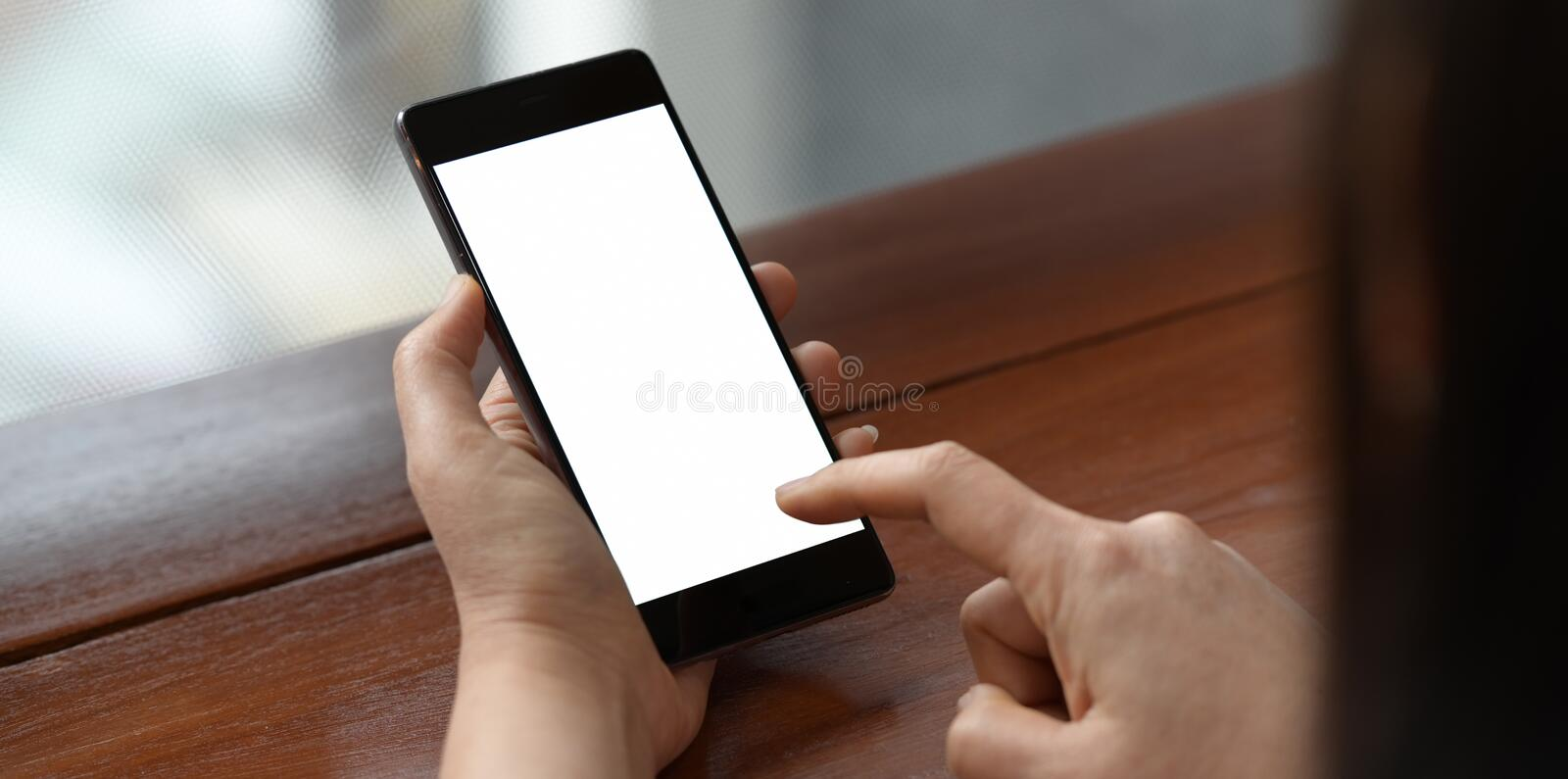 Woman using mobile smart phone. royalty free stock photography