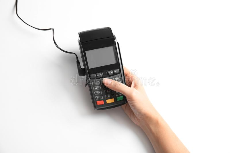 Woman using modern payment terminal on white background, top view stock image
