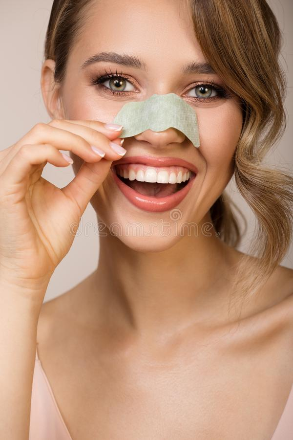 Woman using nose applicator mask. Happy woman using nose applicator mask royalty free stock photos