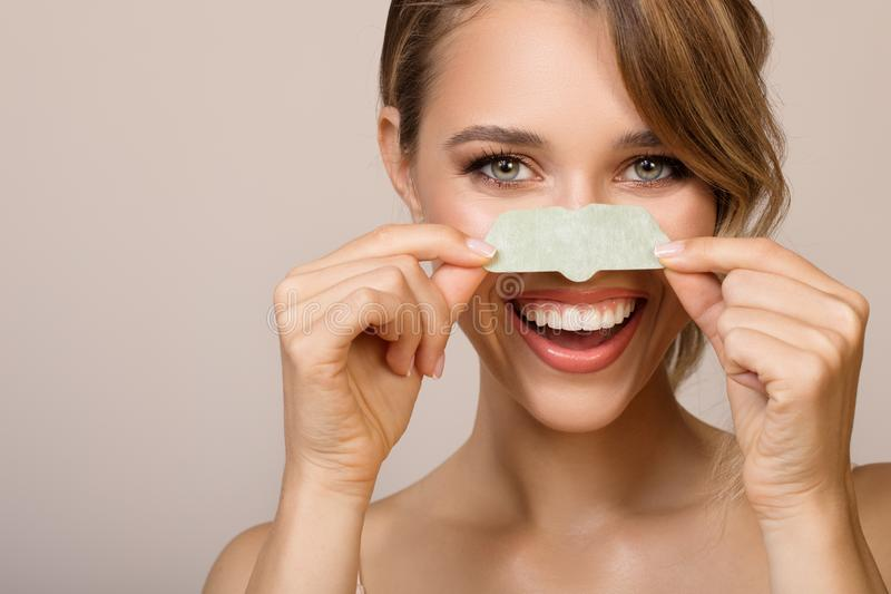 Woman using nose applicator mask. Happy woman using nose applicator mask stock photos
