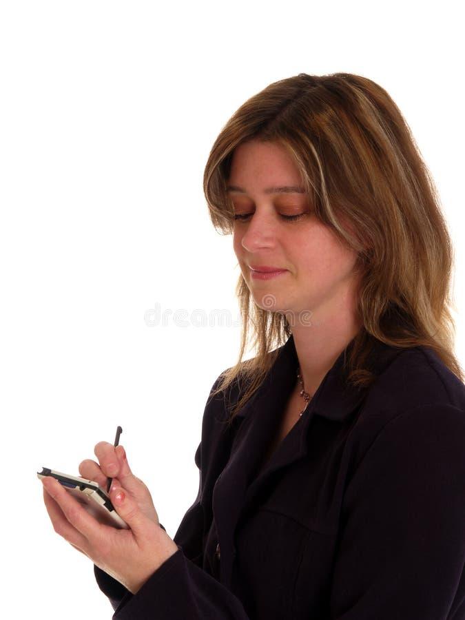 Woman using a pda stock photos