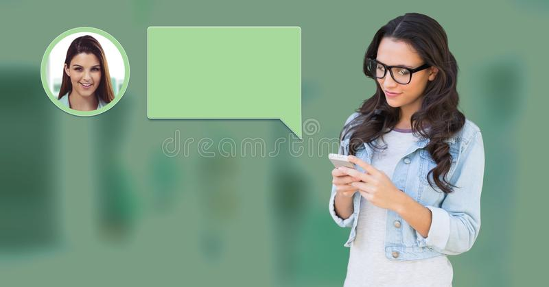 Woman using phone with chat bubble messaging profile stock photo
