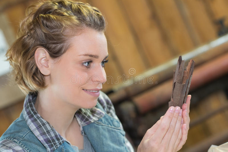 Woman using rare wood chips making handicrafts stock image