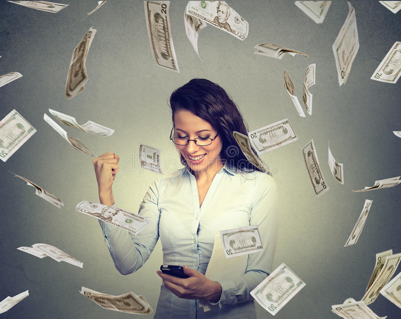 Woman using smart phone building online business making money dollars falling down stock photos