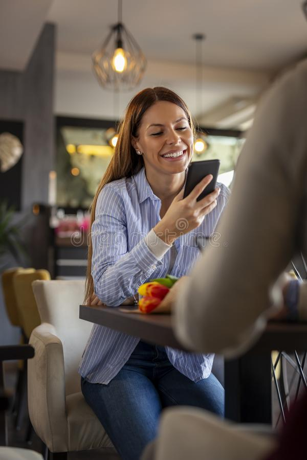 Woman using smart phone on a date royalty free stock photos