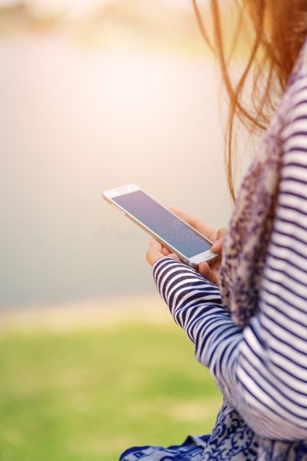 Woman using smart phone. stock image