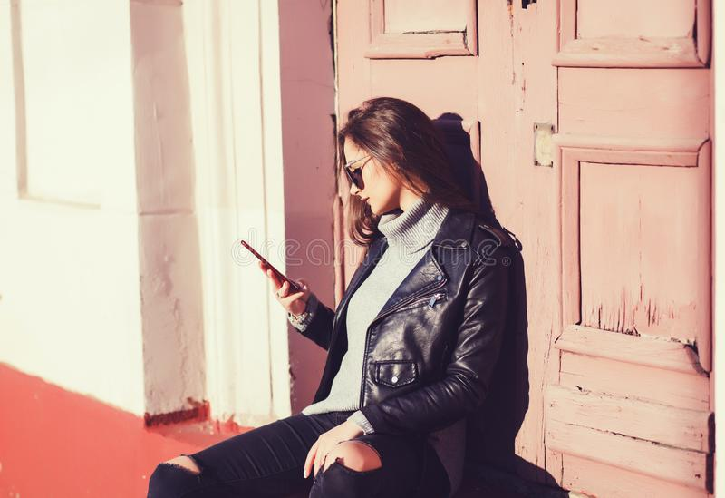 Woman using smartphone in the European city royalty free stock images