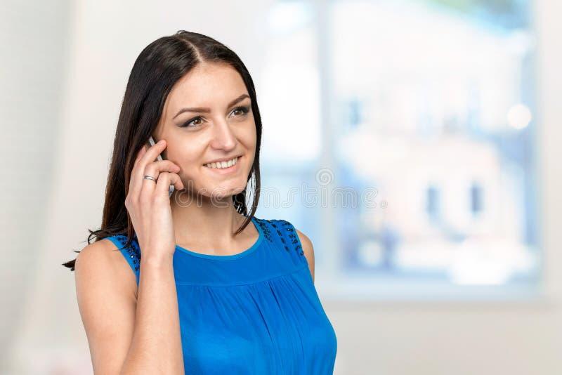Woman using smartphone royalty free stock photos