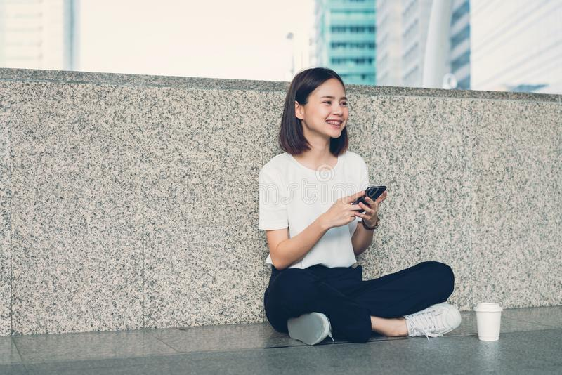 Woman using smartphone, During leisure time. The concept of using the phone is essential in everyday life. Woman using smartphone, During leisure time. The royalty free stock image