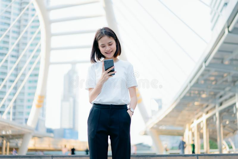 Woman using smartphone, During leisure time. The concept of using the phone is essential in everyday life. Woman using smartphone, During leisure time. The royalty free stock images