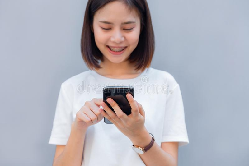 Woman using smartphone, During leisure time. The concept of using the phone. stock photo