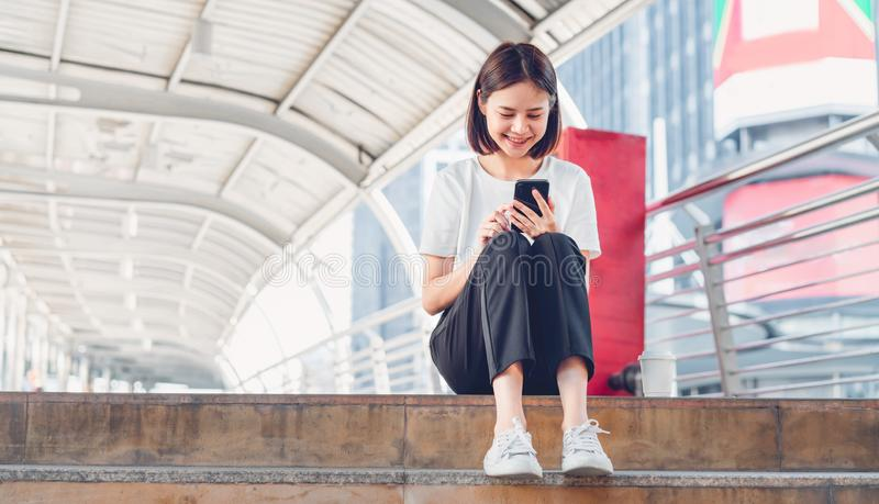 Woman using smartphone, During leisure time. The concept of using the phone is essential in everyday life. Woman using smartphone, During leisure time. The stock photos