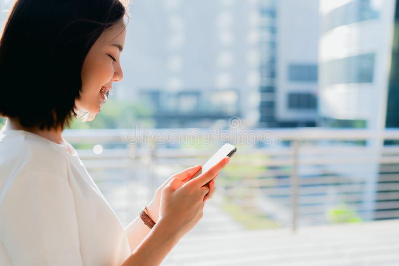 Woman using smartphone, During leisure time. The concept of using the phone is essential in everyday life. Woman using smartphone, During leisure time. The royalty free stock photo