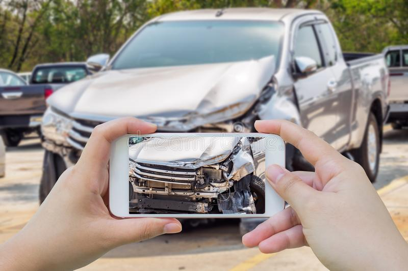 woman using smartphone taking photo of car accident stock image