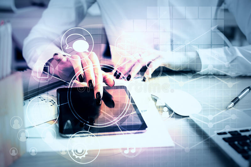 Woman using tablet with business diagram. Close up of young businesswoman at workplace using tablet with circular business diagram. Technology concept royalty free stock photo