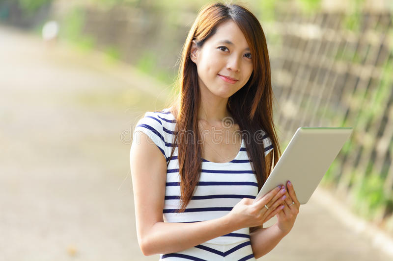 Woman Using Tablet Computer Stock Photography