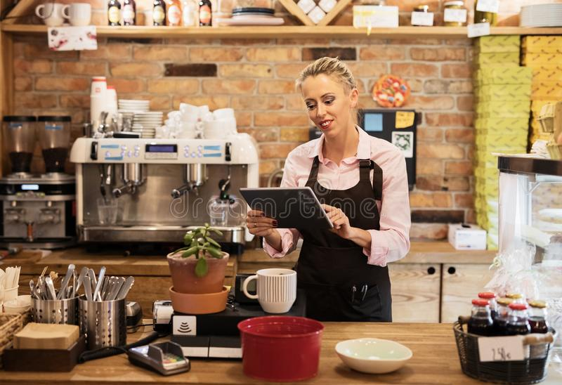 Woman using tablet computer in cafe stock photos