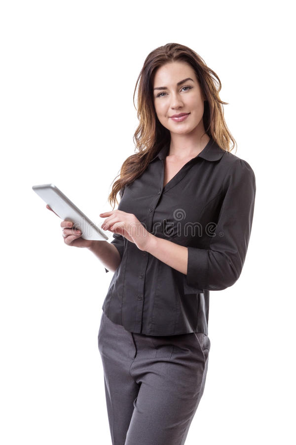 Woman using tablet computer. Pretty young business model holding her tablet computer stock image