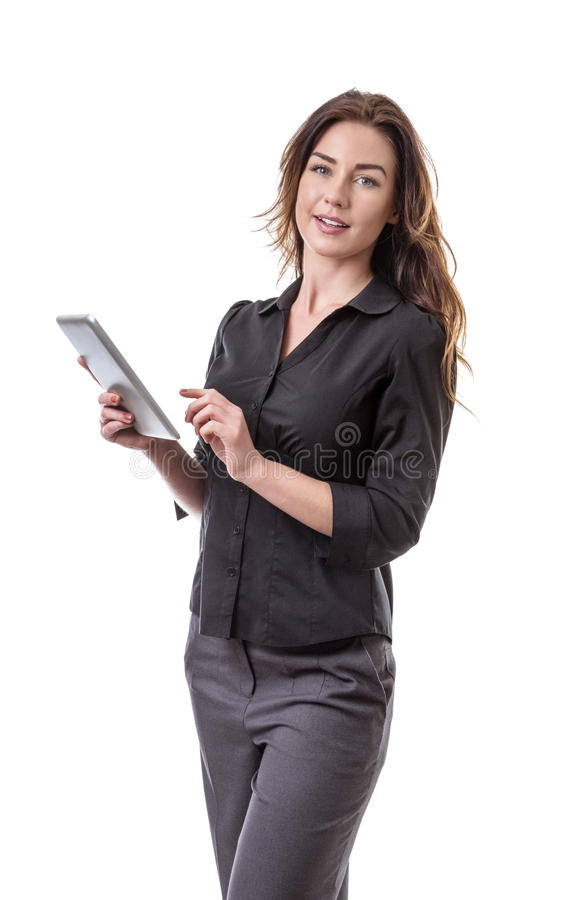 Woman using tablet computer. Pretty young business model holding her tablet computer stock images