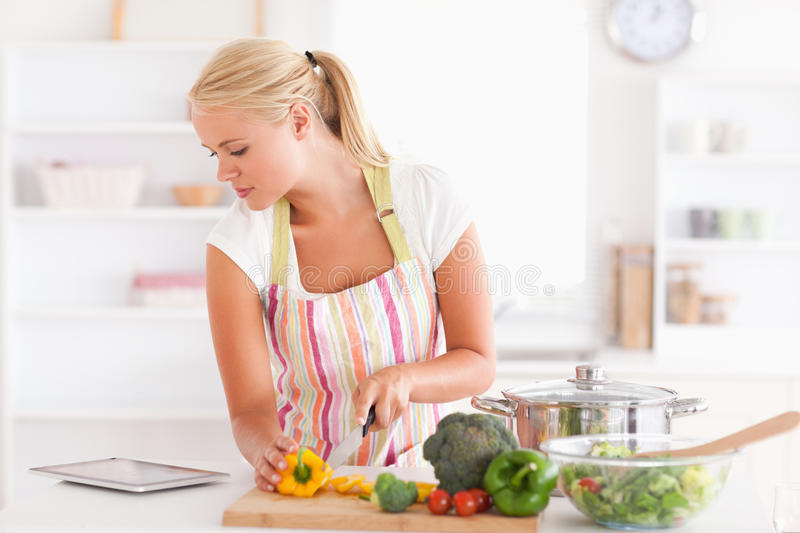 Woman using a tablet computer to cook stock photo
