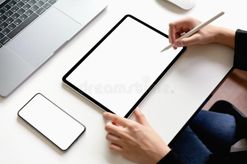 Woman using tablet, laptop and smart phone on the table, mock up of blank screen. stock images