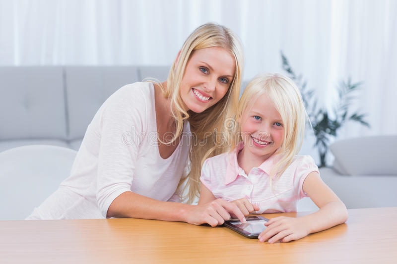 Download Woman Using Tablet Pc With Her Daughter Stock Image - Image: 31448551