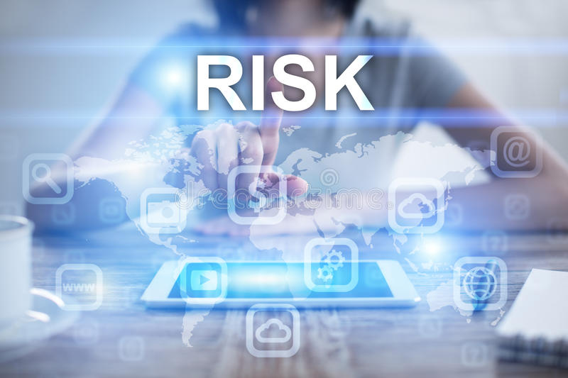 Woman using tablet pc, pressing on virtual screen and selecting risk stock photography