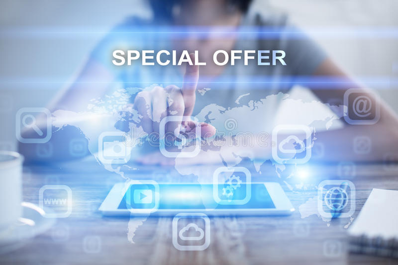 Woman using tablet pc, pressing on virtual screen and selecting special offer stock photography