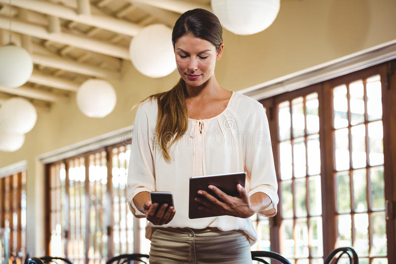Woman using technology royalty free stock images