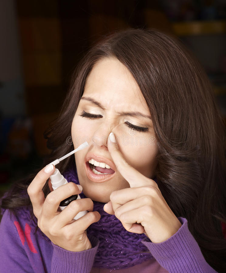 Download Woman Using Throat Spray. Stock Images - Image: 18005314