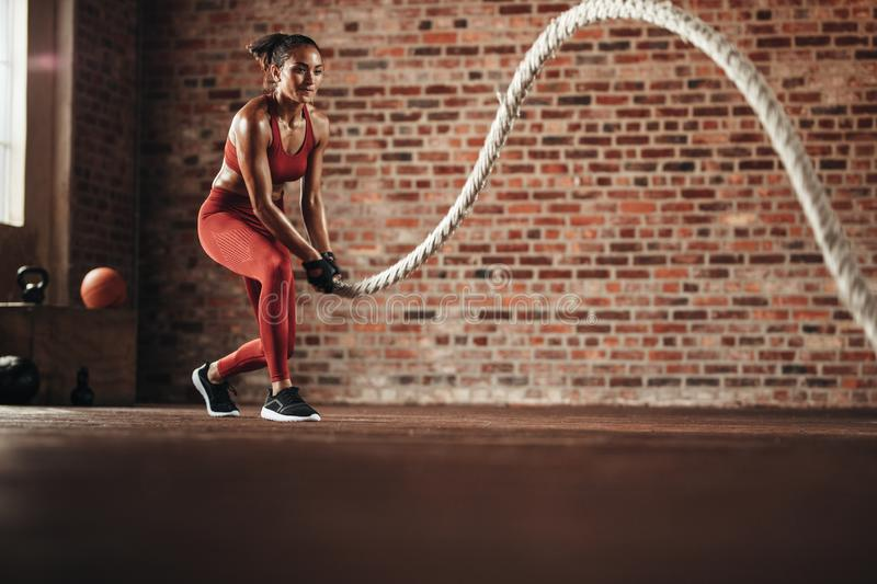 Woman doing cross training routine royalty free stock photo