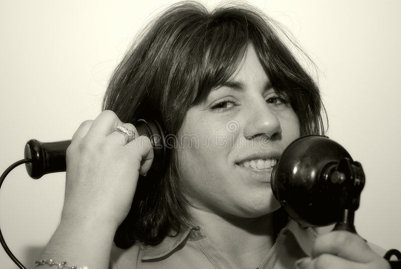 Download Woman Using A Vintage Phone Royalty Free Stock Photo - Image: 104825