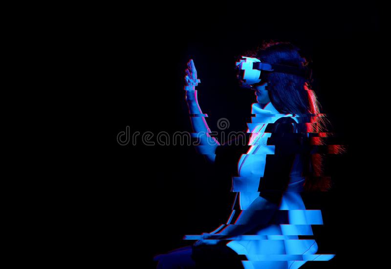 Woman is using virtual reality headset. Image with glitch effect. royalty free stock images