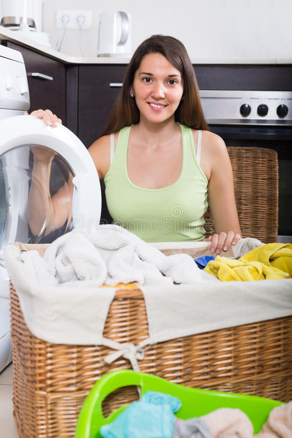 Woman using washing machine stock images