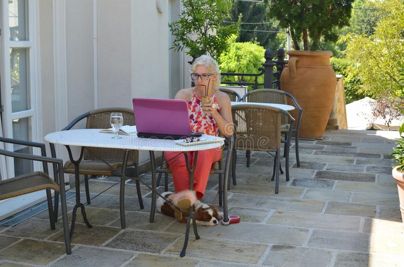 Business woman working on vacation stock images