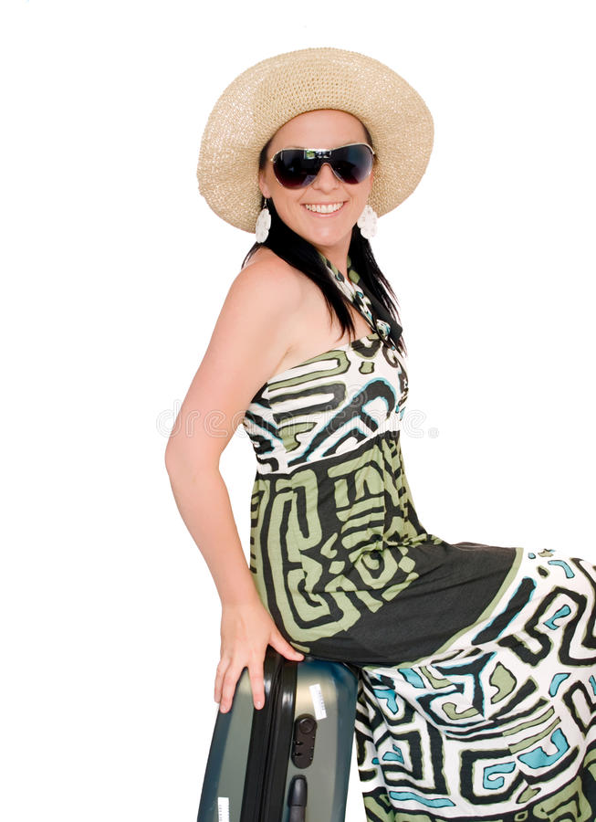 Woman on vacation with suitcase over white