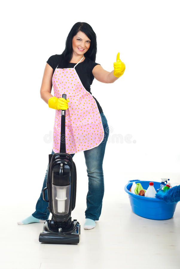Woman with vacuum cleaner gives thumbs royalty free stock photography