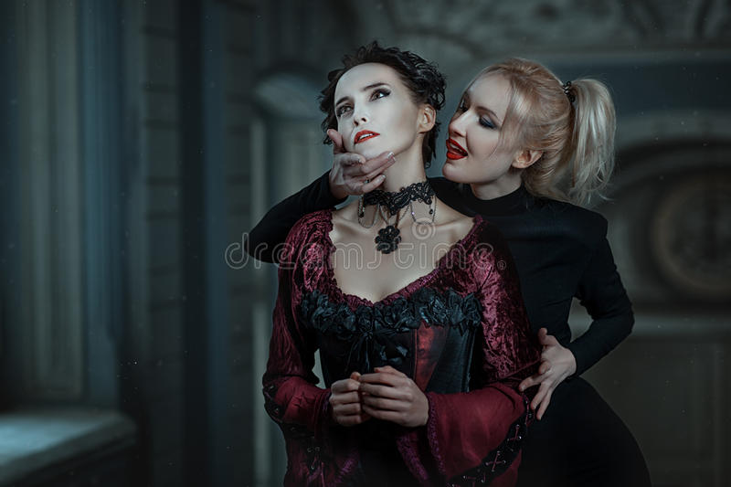 Woman vampire bites. stock images