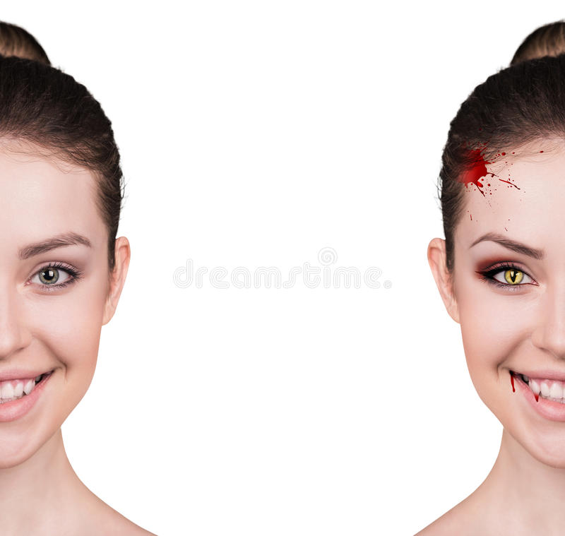 Woman with vampire fangs. Beautiful woman with vampire fangs isolated on white stock images
