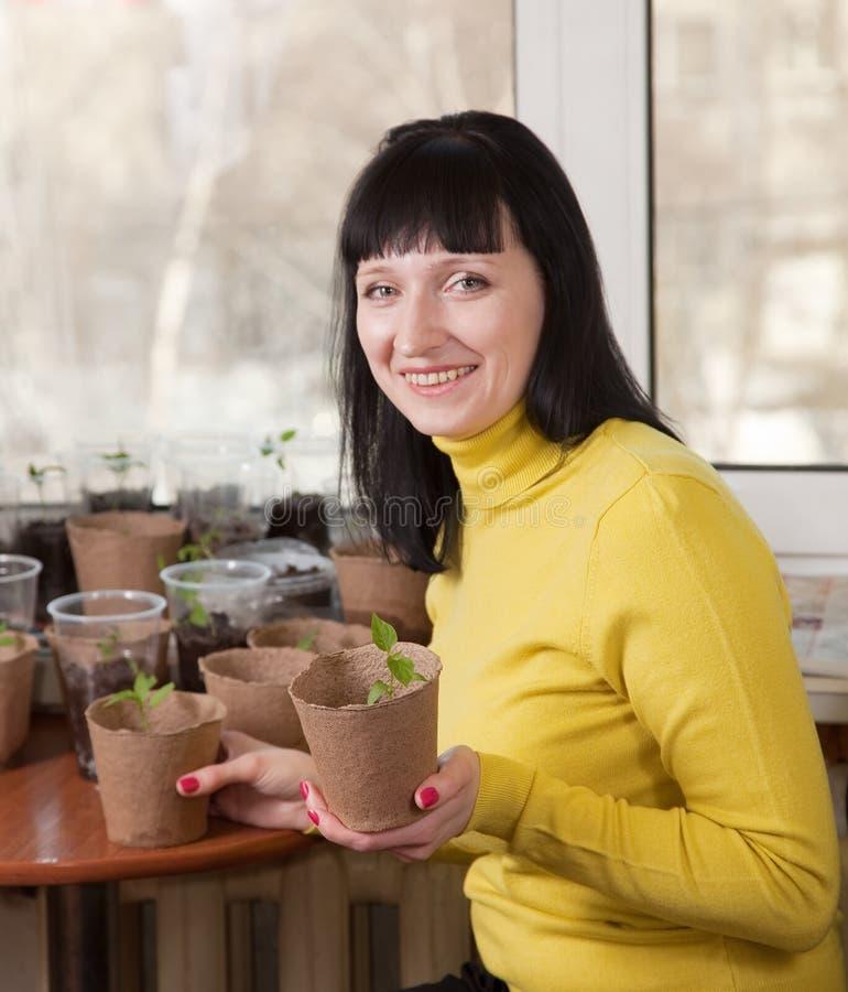 Woman with various seedlings