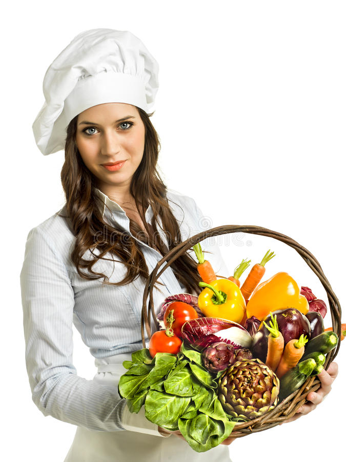 Chef with basket of fresh vegetables. A female chef with a basket full of fresh vegetables and fruits royalty free stock images