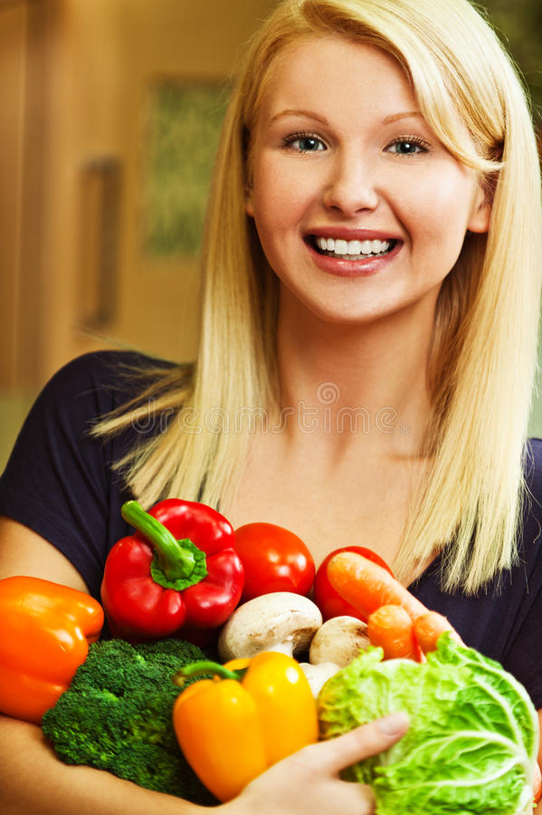 Woman With Vegetables In Hands Royalty Free Stock Image