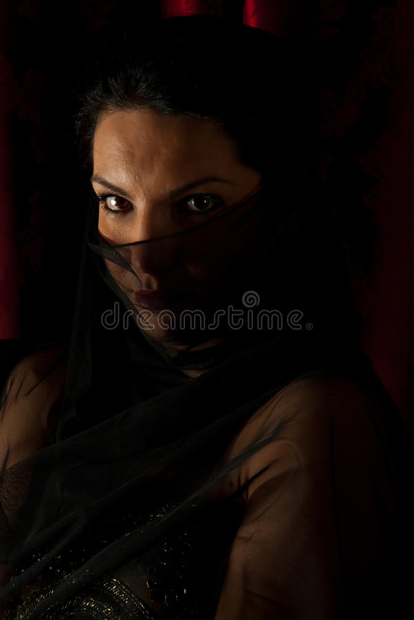 Woman with veil on face in night stock image