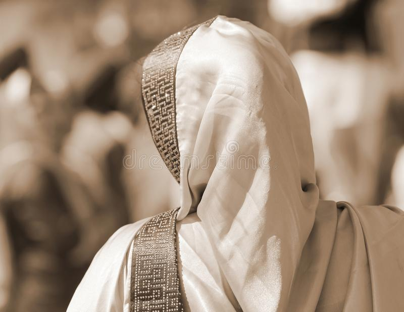 Woman with veil over her head with sepia effect royalty free stock photo