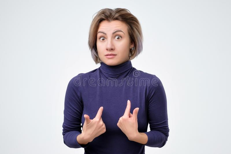 Woman verbally defending herself, having perplexed expression royalty free stock photography
