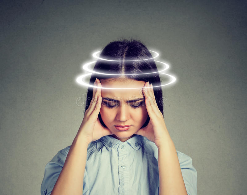 Woman with vertigo. Young female patient suffering from dizziness. royalty free stock image