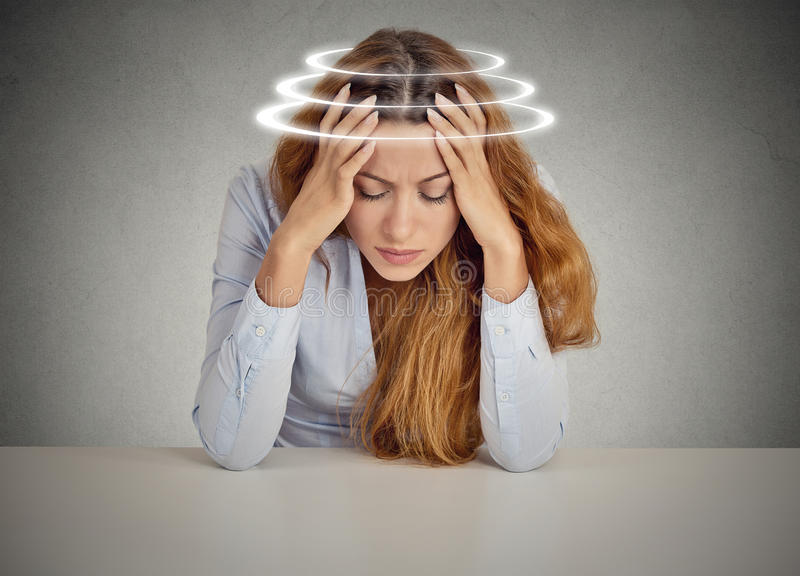 Woman with vertigo. Young female patient suffering from dizziness royalty free stock images
