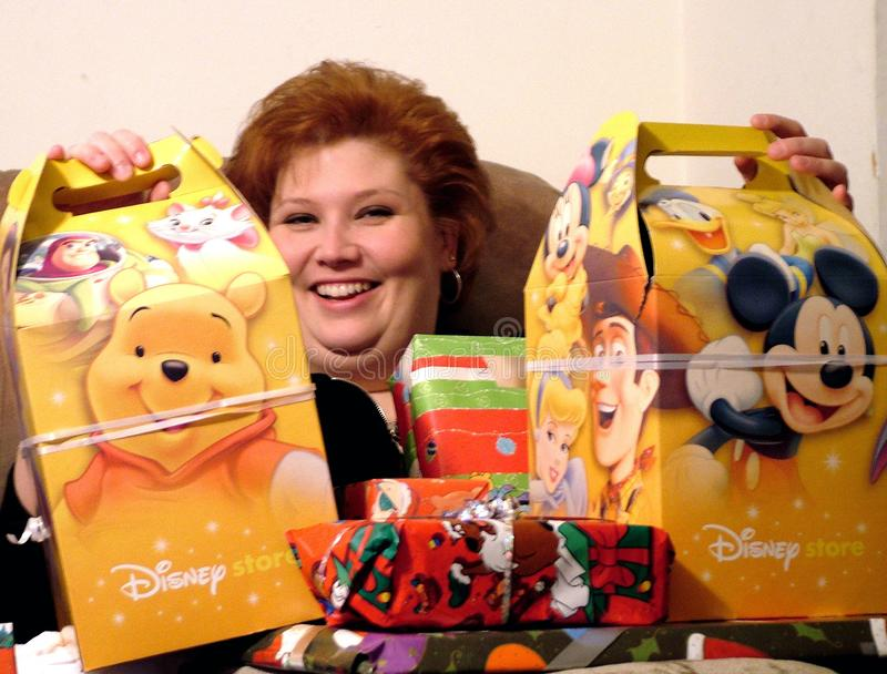 Woman is very appreciative with the Christmas gifts she received. A very happy and appreciative woman opens her Christmas gifts stock images